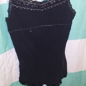 A black tank top with a sports bra built into it